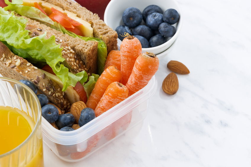 lunch box with sandwich of wholemeal bread on white background, closeup