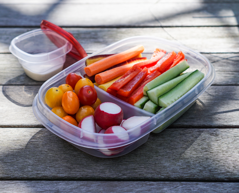 Plastic container/lunch box with vegetables, crudités, healthy eating concept, selective focus